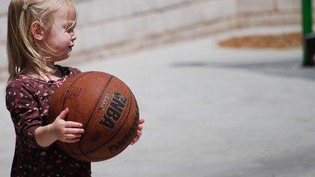 blond little girl with basketball ball
