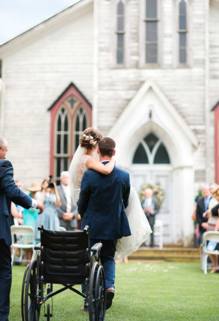 groom-carries-bride-altar-hands-story-love-knows-no-barriers-3